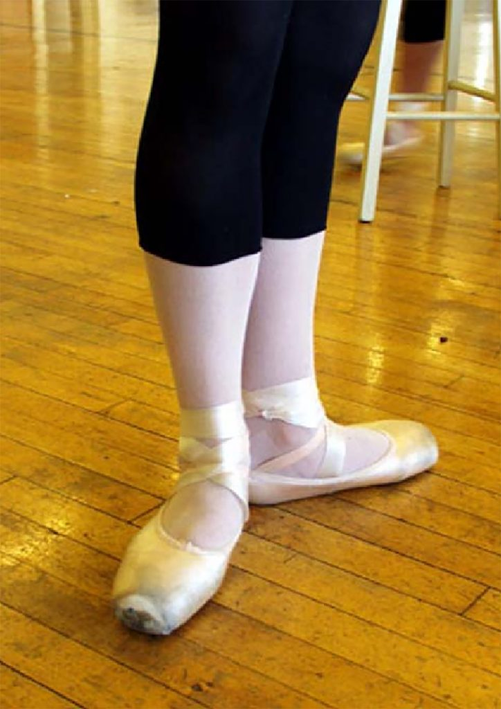 picture of dancer with inside foot arches rolling